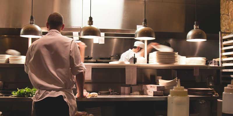 3 chefs working in a restaurant kitchen