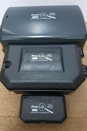 three grey pest id bait boxes